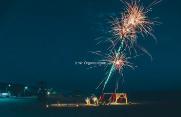 Organization of Proposal on Beach with Illuminated Letters